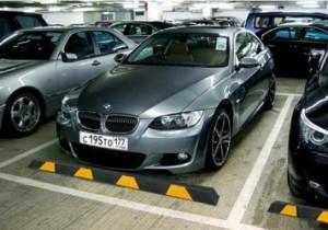 Колесоотбойники – оборудование для организации парковок
